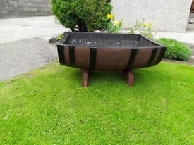 Whisky barrel cradle planters