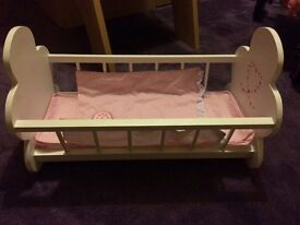 A baby doll cot