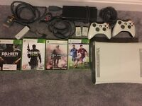 Microsoft Xbox 360 with 20gb hard drive 2 controllers, wifi adapter and 4 games