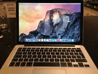 MacBook Pro , Late 2013 , Retina display, 8GB RAM , 2.5 Ghz Intel Core i5 Processor , 13 Inch.