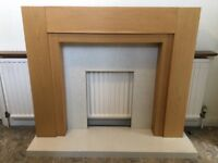 Oak Fire Surround with marble back & hearth. 2 spotlights in surround.