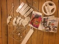 Wii with numerous games and additional controllers quick sale required