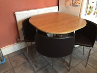 Table and 4 chairs space saver