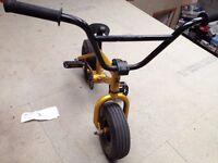 gold KRAUZE mini stunt bike