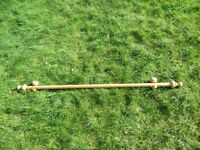 130cm wooden light coloured pine curtain pole with finials and supports