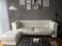 1x two seater sofa, 1x three seater sofa and a foot stall. White leather Ikea.