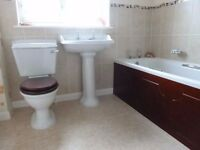 used bathroom suite white excellent condition five years old with hardwood panels buyer collects