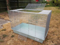 Large cage for small pets with accessories and food
