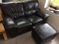 Black leather 2 seater sofa and footstool