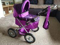 Purple and pink dolls pram