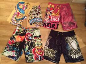 4 brand new Christian Audigier and Ed Hardy men's boardshorts. Waist 33 and 32. Authentic