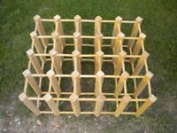A 25 BOTTLE WINE RACK IN PINE
