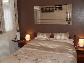 Double en-suite room for single person, shared lounge and kitchen.