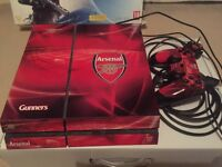 PlayStation 4 console with Arsenal Skin, boxed ( box bit damaged)