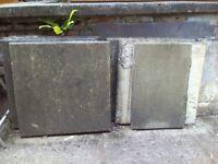Seven 60 cm x 60 cm Paving Slabs and five Half Slabs