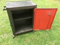 Metal storage chest on wheels