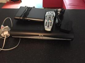 Sky + HD box with remote control broadband box and wireless connector