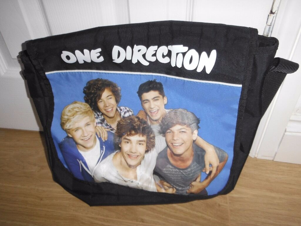One Direction Messenger Bag Ideal For School Or Just As A Spare Bagin Seaham, County DurhamGumtree - One Direction Messenger Bag Ideal For School Or Just As A Spare Bag This is for any one direction fan. This has an adjustable shoulder strap & is soft material ideal for school homework or PE or anything really. There is some cracks on the material...