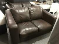 2 small brown leather 2 seater sofas