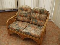 Conservatory set -Cane settee, two chairs and lamp table