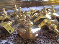 12 Brass carpet rods & 24 urn finials & brackets