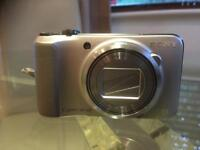 Sony DSC HX10V 18.2MP digital camera, with 4GB memory card and case