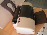 Epson C44 Plus printer. This is NOT a scanner.
