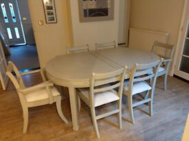 Painted Hardwood dining table - seats 10 - 12 with centre extension and comes with 6 covered chairs.