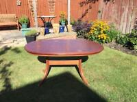 Cherry wood extending dining table and 6 chairs