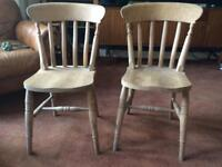 Two solid wood vintage chairs