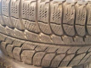 4 pneus d'hiver 185/65R14 Michelin X-Ice. 50% d'usure, mesure 6-6-7-7/32.