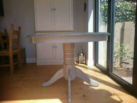 Round painted dining table