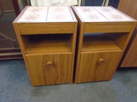 2 tiled topped bedside cabinets.