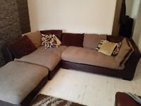 Large corner couch with pouffe