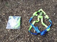 Two brand new adult climbing / safety harnesses