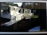 ! good deals for june !! caravan for hire at haggerston castle , decking area with wi-fi .