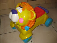 FISHER PRICE WALK & RIDE LION + FREE MUSICAL BABY TOY - BARGAIN!