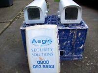 Pair of security camera housing, including alarm fascia