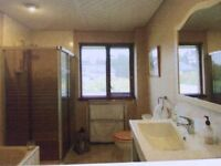 A spacious bungalow in the village of Tomatin, commuting distance to Inverness