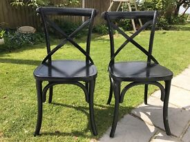 Pair of solid black cross back chair