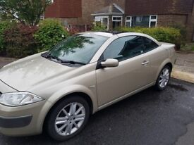 Renault magane convertible gold colour. Green leather interior
