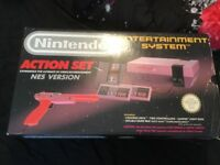 NES with four games and gun very good condition all boxed with poly insert