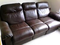 Brown Leather Sofa,under a year old in very good condition.