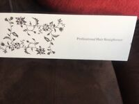 Steam hair straighteners