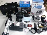 Canon 400D digital camera with multiple accessories