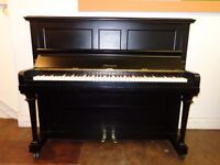 Claremont upright piano in an ebony case