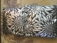 2x black & silver cushions
