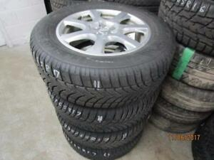 235/65R17 SET OF 4 USED DUNLOP SNOW TIRES ON AUDI  2015 Q5 ALLOY RIMS