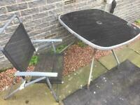 Garden chairs 4 & glass top table need cleaning £20.