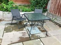 Garden furniture: glass table, 4 chairs, parasol base